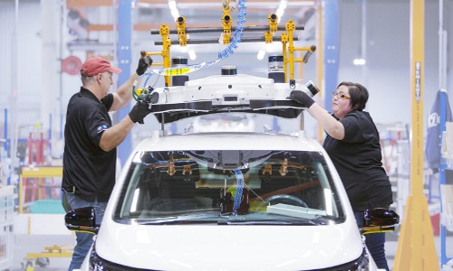 GM workers assemble a test car